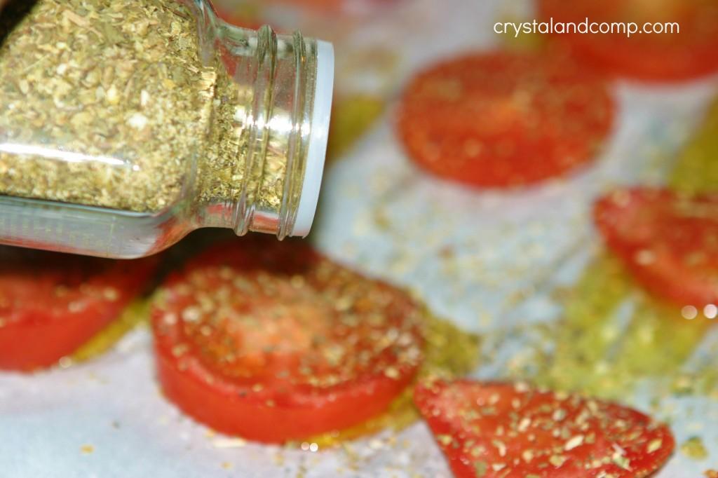 italian seasoning on tomatoes slices