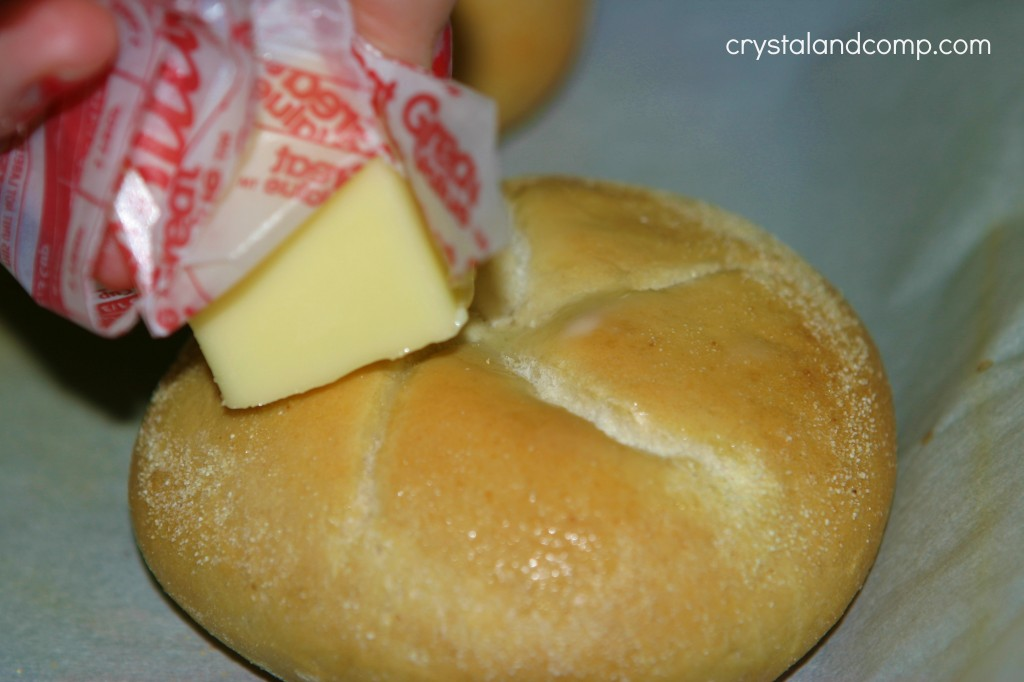 add butter to the tops of the Schwans rolls