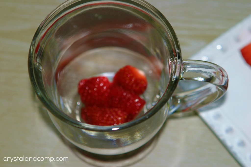 place strawberries in a parfait cup