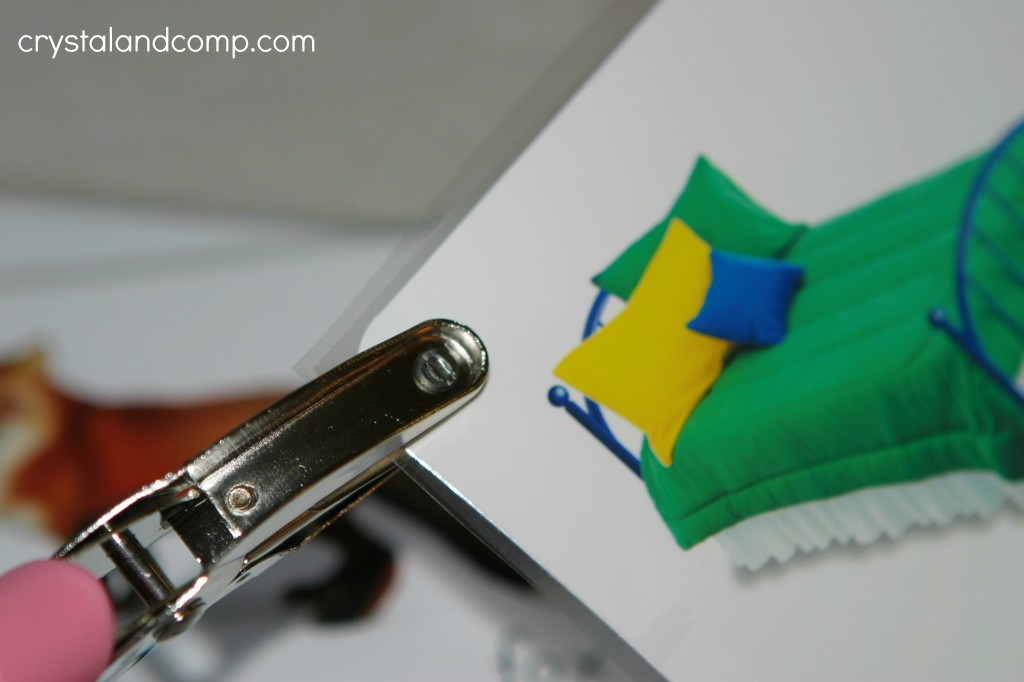 use a hole punch to make a hole in the upper corner
