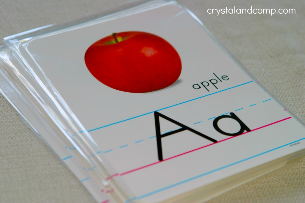 use bulletan board photo alphabet cards by trand to make an ABC flip book