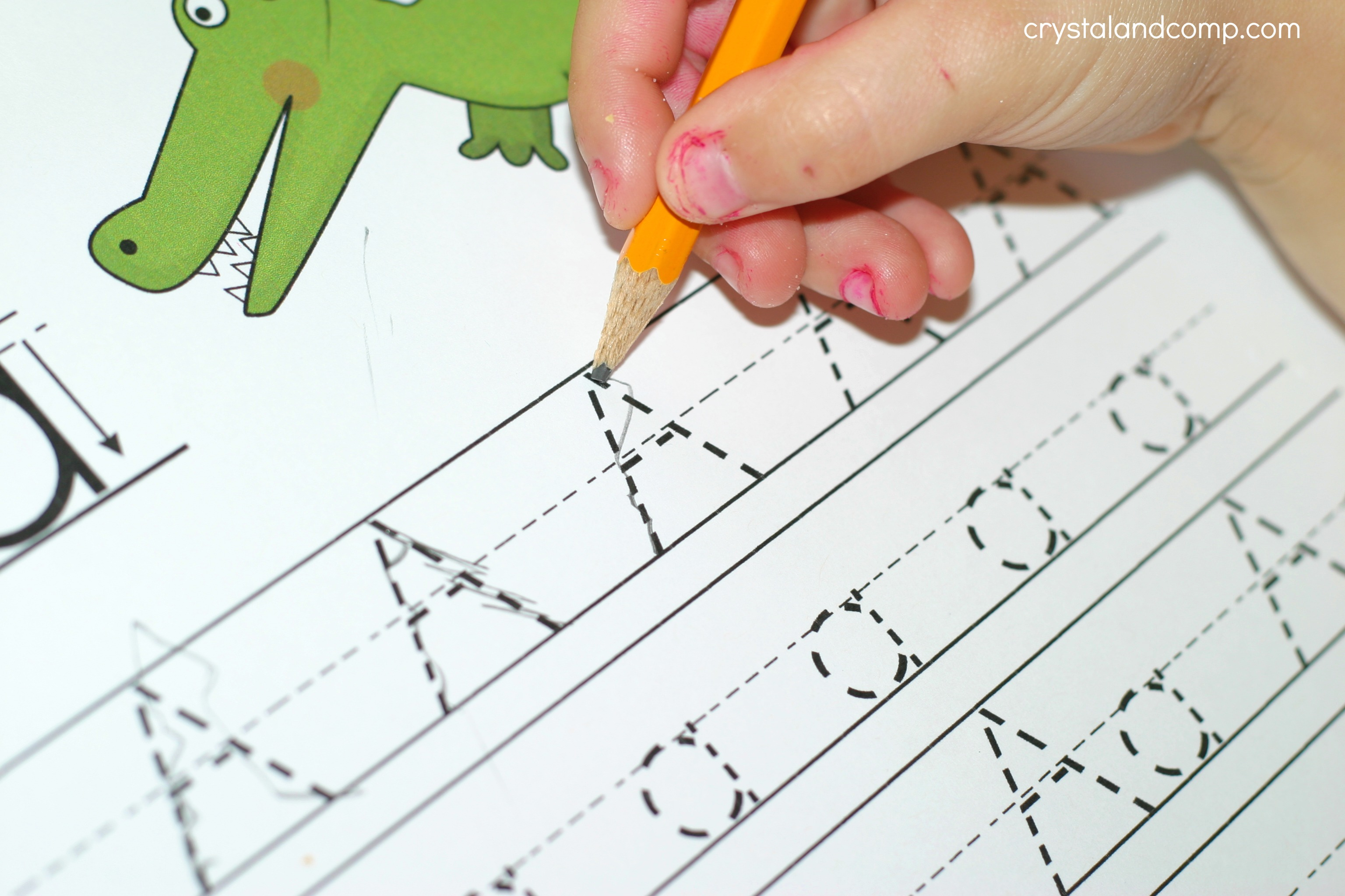 It is a graphic of Crafty Kids Letter Tracing