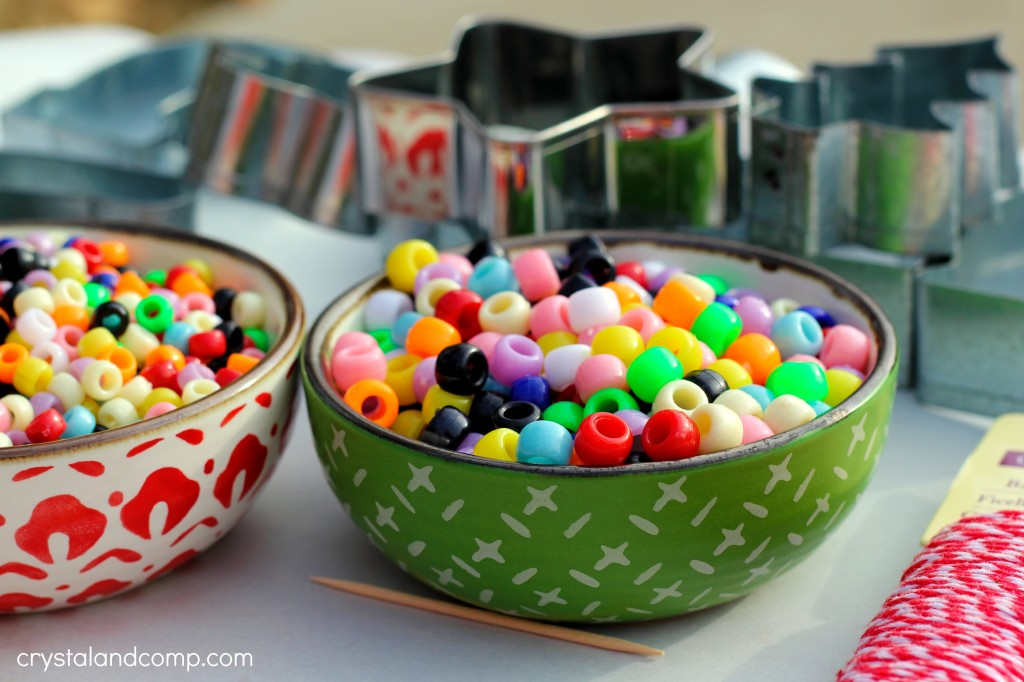 how to use pony beads and cookie cutters to make Christmas ornaments