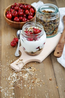 Yogurt in a jar with granola and cherry