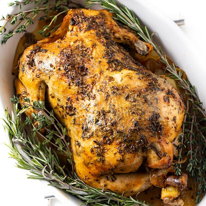Crock-Pot Whole Chicken Recipe With Garlic Herb Butter (VIDEO)